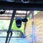 Regensensor neben Spiegel